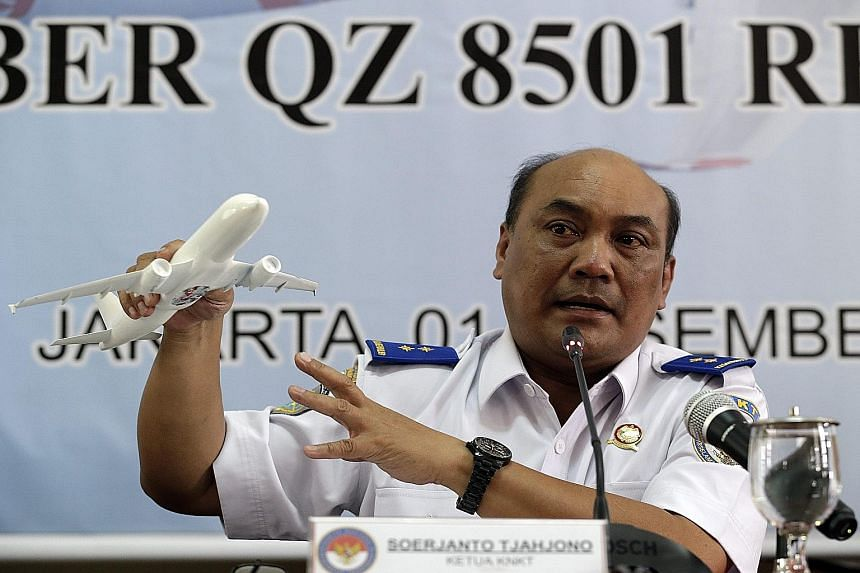 Indonesia's National Transportation Safety Committee head Soerjanto Tjahjono (left) speaking at a Jakarta press conference on Tuesday about the panel's findings into the Flight QZ8501 crash. Pilots Iriyanto (top) and Remi Emmanuel Plesel lost control