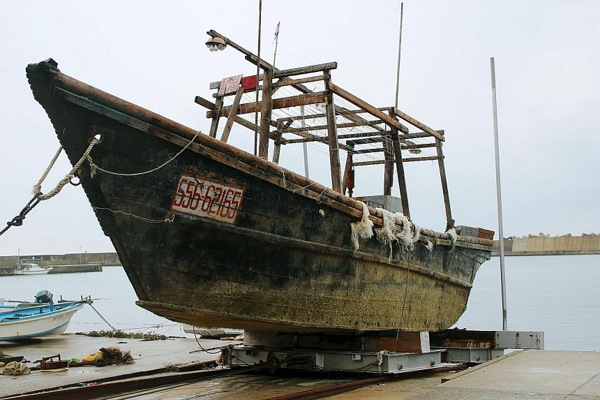 This unidentified wooden boat was found in the sea off Japan's Noto Peninsula last month.