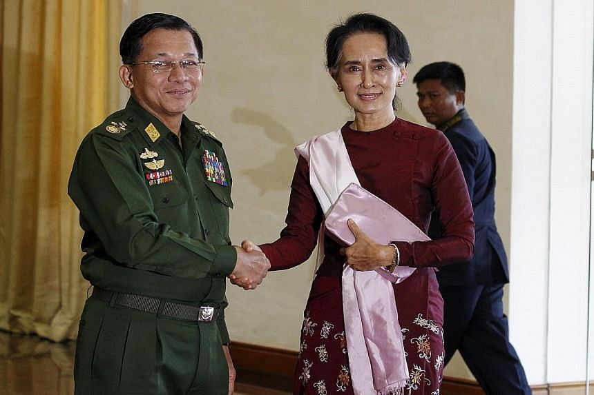 """Above, left: Ms Suu Kyi and Mr Thein Sein during a meeting at his Naypyitaw office yesterday, where he congratulated her on NLD's victory. The opposition leader also met army chief Min Aung Hlaing and they agreed """"to cooperate on stability and peace,"""