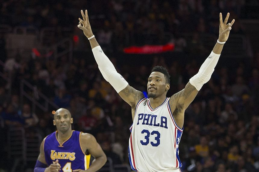 Robert Covington acknowledging the cheers during his 23-point effort, as Philadelphia defeated the Lakers 103-91 to halt their 28-game losing run. Kobe Bryant scored 20 points in his home town.