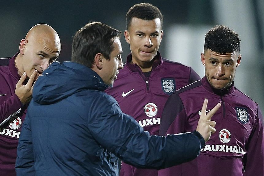 First team coach Gary Neville working with the players during England training. His brother Phil will handle Valencia against Barcelona on Saturday, after which he will take over.