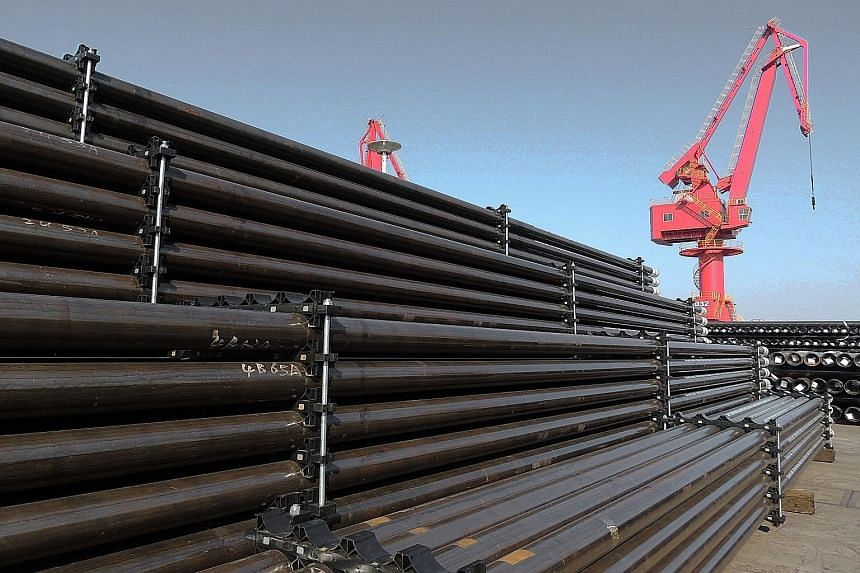 Steel pipes at a port in Jiangsu, China. Tepid growth in Singapore is due to headwinds in China, whose growth will slow down towards the 6.2 per cent to 6.5 per cent range, says UBS' Tan Min Lan.