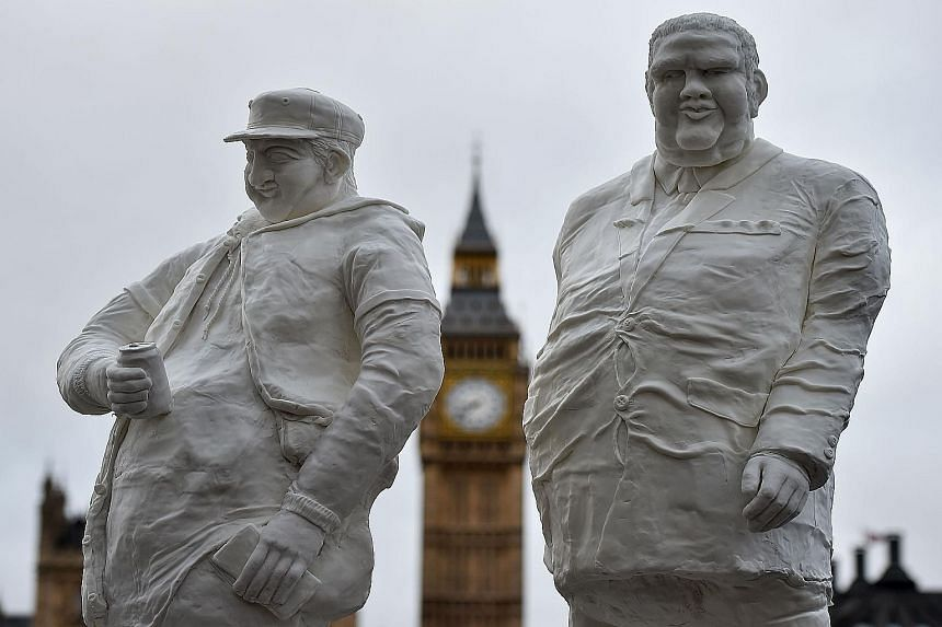 Sculptures made of sugar were put up in front of the Houses of Parliament in London on Tuesday to highlight the need for the public to reduce sugar intake. A parliamentary Health Committee report published on Monday urged British Prime Minister David