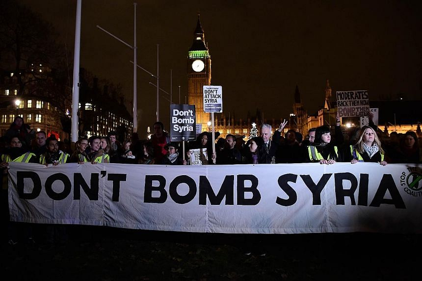 Protesters against British military action in Syria gathered outside the Houses of Parliament in London on Tuesday.