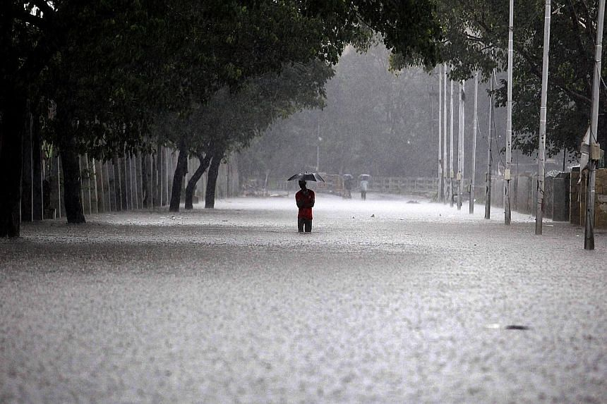 A flood-hit area in the state capital Chennai. Thousands of factories were shut as the heaviest rainfall in over a century caused widespread flooding across Tamil Nadu.