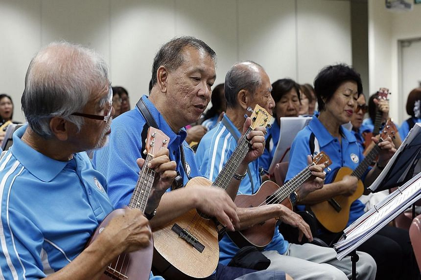 Members of the Bishan Ukes jamming during a session at the Bishan Community Club last month. The group comprises mostly people in their 50s and 60s who meet every Thursday evening to play the ukulele together.