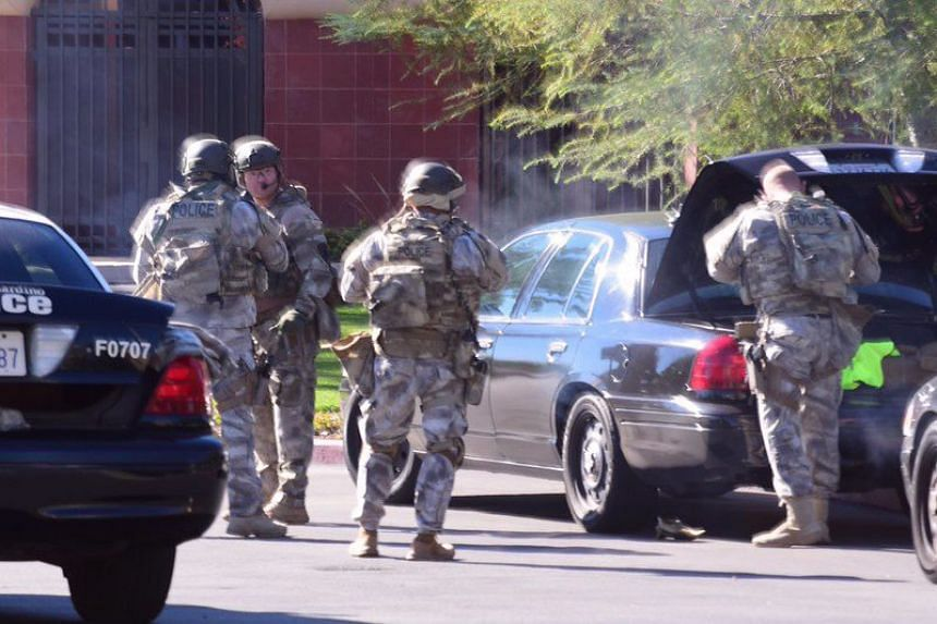 Officers responding at the scene of an active shooter situation near the Inland Regional Centre in San Bernardino, California.