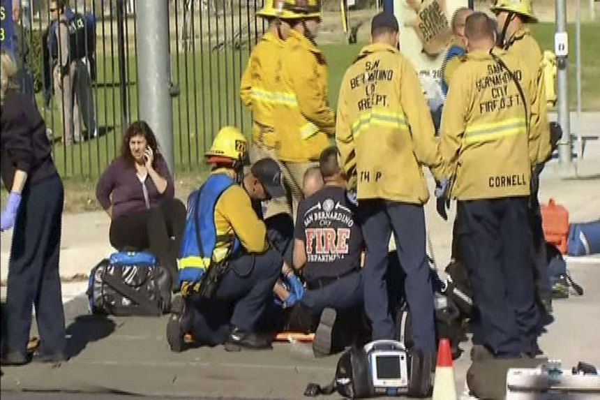 Rescue crews tend to the injured in a still image from video.
