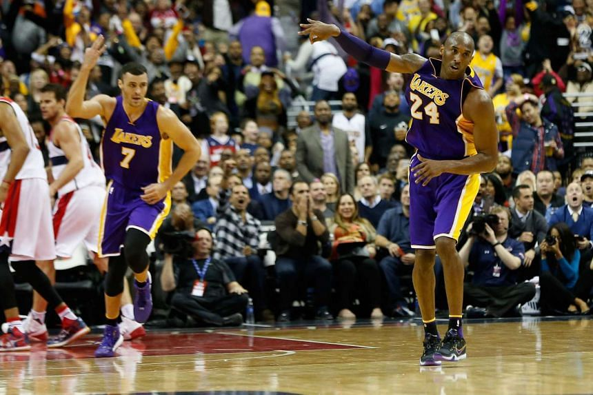 Kobe Bryant #24 of the Los Angeles Lakers celebrates after hitting a three pointer late in the fourth quarter of the Lakers 108-104 win over the Washington Wizards at Verizon Center on Dec 2, 2015, in Washington, DC.