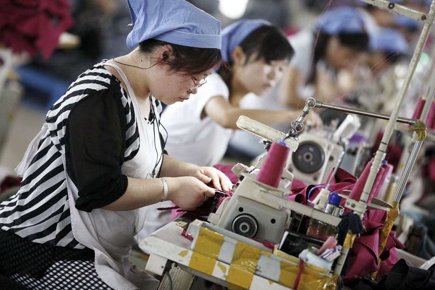 A file picture dated Jun 1, 2015, shows workers making clothes at a factory in Huaibei, China, to be exported.