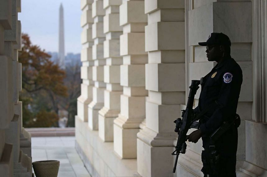 A police officer standing guard at the US Capitol in Washington, DC, on Nov 17.