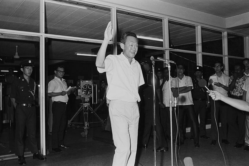 Prime Minister Lee Kuan Yew waving to the crowd from the Singapore Polytechnic counting centre after his victory in the general elections was announced in 1972.