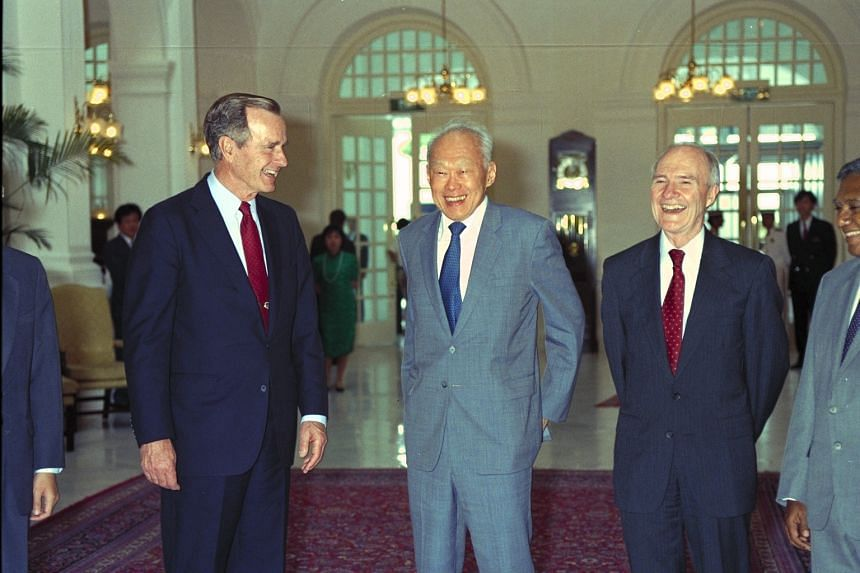 (From left) Former US president George Bush, Senior Minister Lee Kuan Yew and National Security Adviser Brent Scowcroft at Raffles Hotel in 1992.