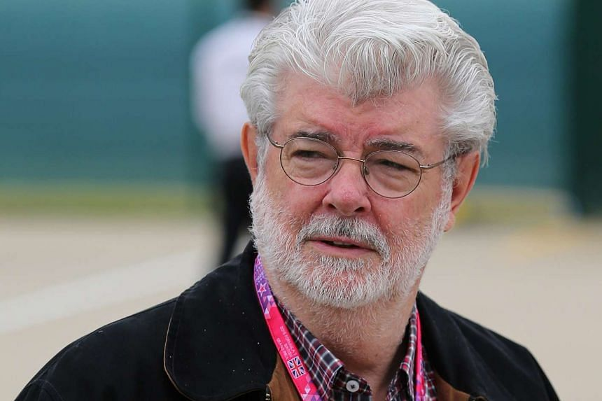 Film director George Lucas walks through the pit area prior to the Formula One British Grand Prix 2015 in Silverstone, England in this July 5, 2015 file photo.