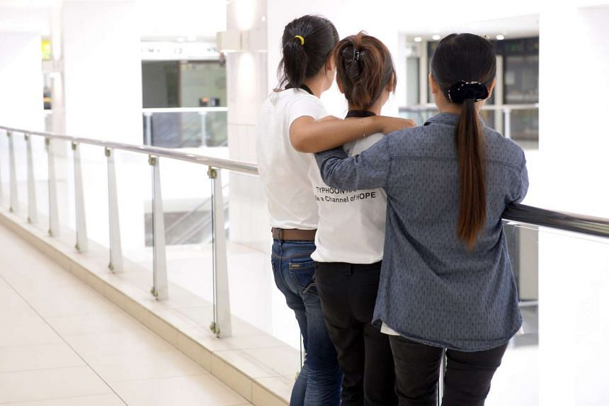 Posed photo of foreign domestic workers.
