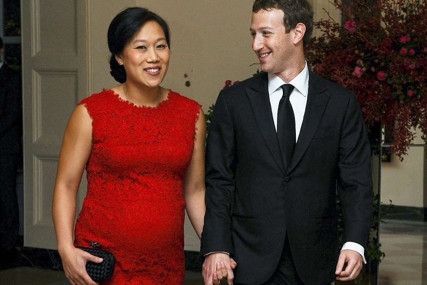 Mark Zuckerberg, Chairman and CEO of Facebook, and his wife, Priscilla Chan, arrive for an official State dinner at the White House in Washington, in this Sept 25, 2015, file photo.