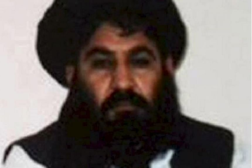 It was unclear if Mullah Akhtar Mansour (above) survived the clash.