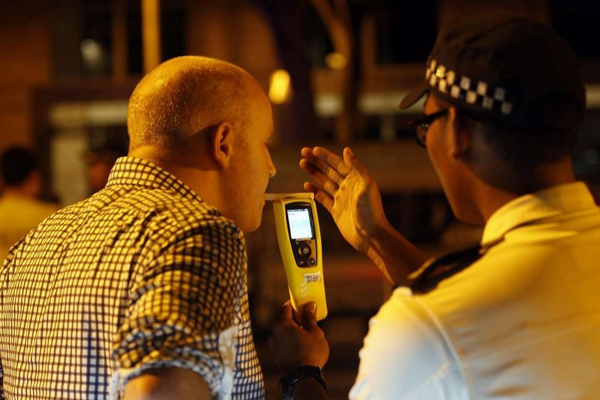 A driver being tested for drink drinking during the police operation.