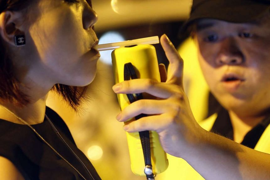A driver being tested for drink drinking.