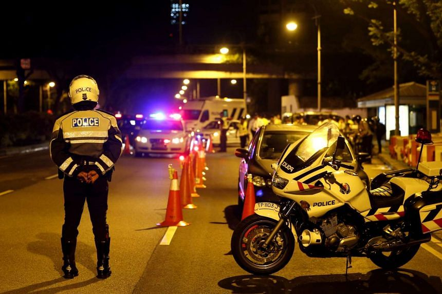More than 20 police officers were seen at a road block carrying out different duties, from identifying possible drink drivers to testing them with handheld breathalysers on Dec 3, 2015.