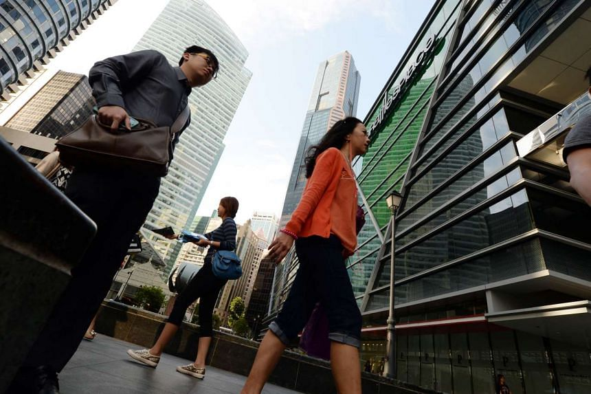 Office workers at Raffles Place.
