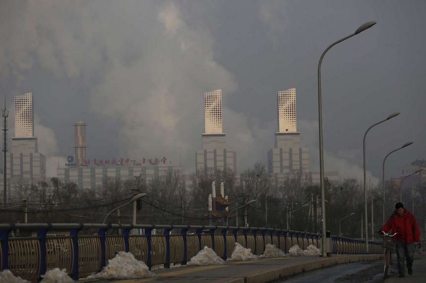 A power plant belches smoke on a hazy day on the outskirts of Beijing.