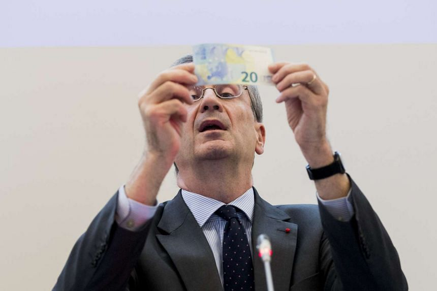 Mr Francois Villeroy de Galhau, governor of the Bank of France, holding a new €20 note. Europe's 19-nation shared currency has approached its weakest level since April, ahead of the release of a series of crucial data.