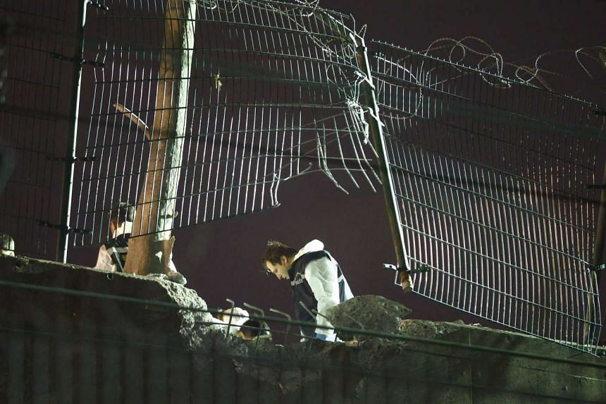 Forensic officers work on the blast scene in Istanbul, Turkey, on Dec 1.