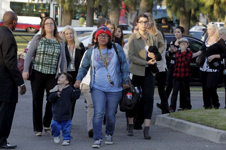 Survivors of the Inland Regional Center being escorted off the buses to meet relatives at the Rudy Hernandez Community Center in San Bernardino, California, on Dec 2, 2015.