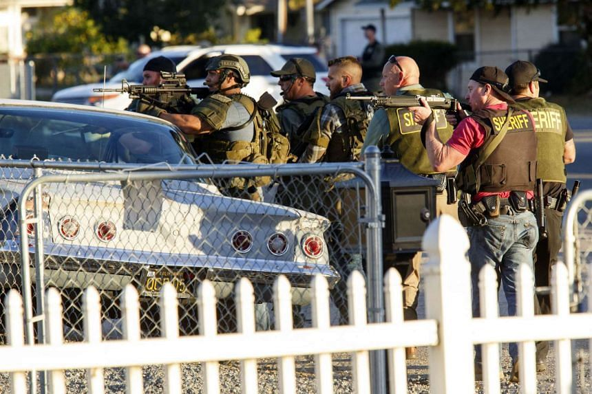Law enforcement officers search for the suspects of the mass shooting.