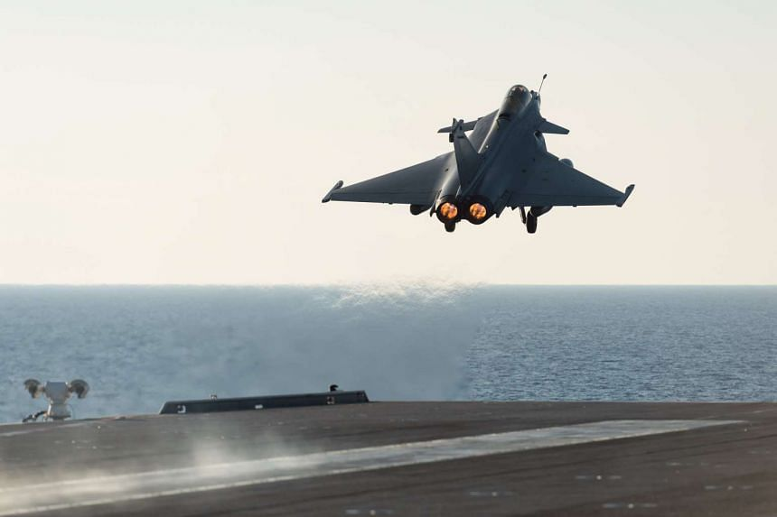 A rafale aircraft takes-off from the Charles de Gaulle during operations in the Mediterranean Sea.
