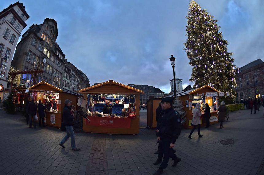 Policemen patrol at the city's Christmas market.