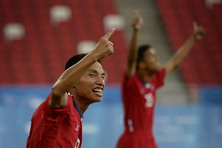 Paisan Saecho celebrates after scoring against Malaysia during the Cerebral Palsy football match on Nov 3, 2015.