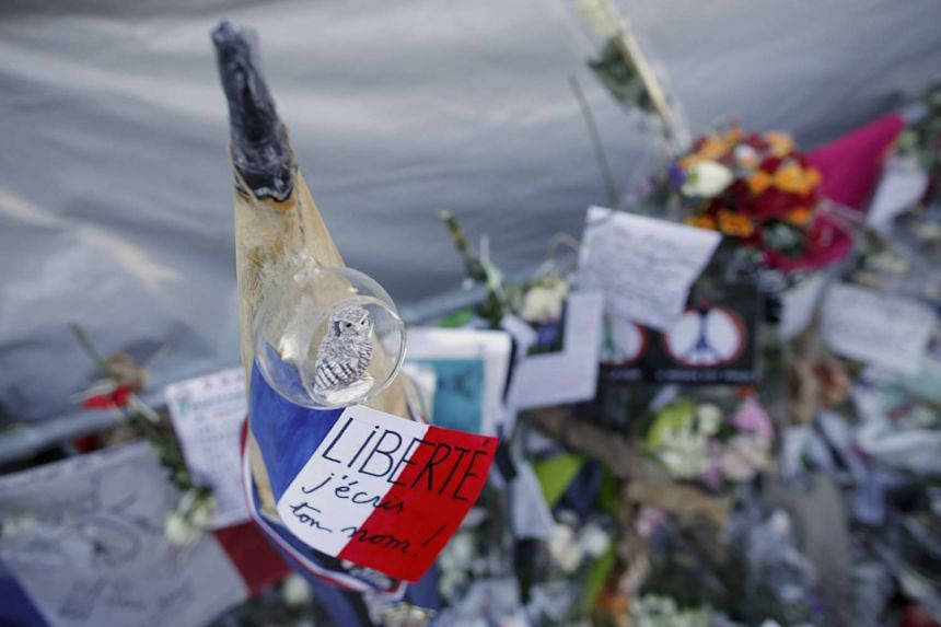 Flowers in front of the Bataclan concert hall to pay tribute to the shooting victims in Paris.