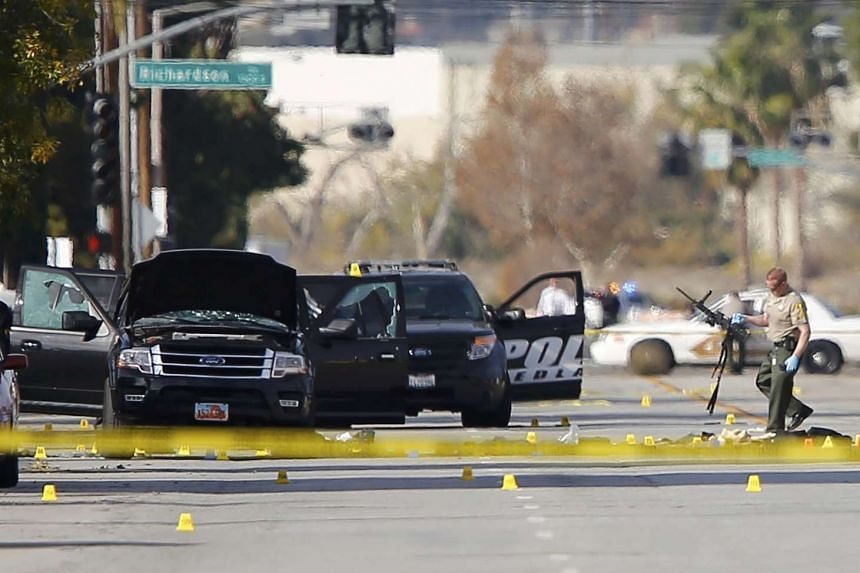 A police officer at the scene of the investigation following a mass shooting in San Bernardino.