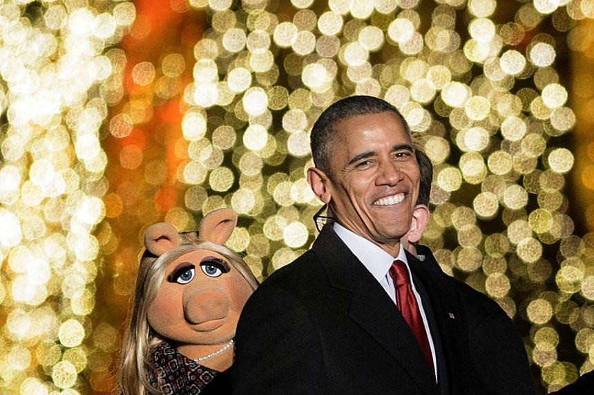 US President Barack Obama leaves after singing Christmas songs on the Ellipse of the National Mall on Dec 3 in Washington, DC.