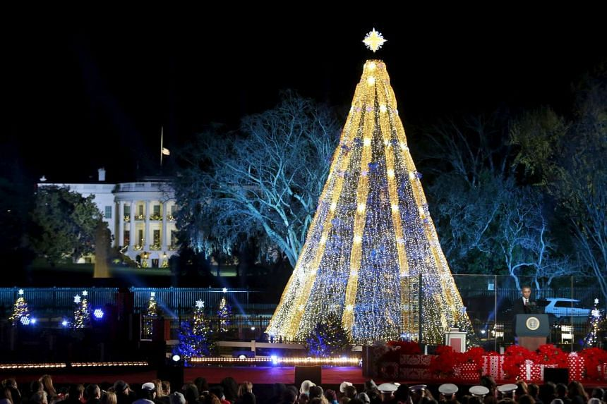 US President Barack Obama speaks during the National Christmas Tree Lighting and Pageant of Peace ceremony near White House in Washington on Dec 3