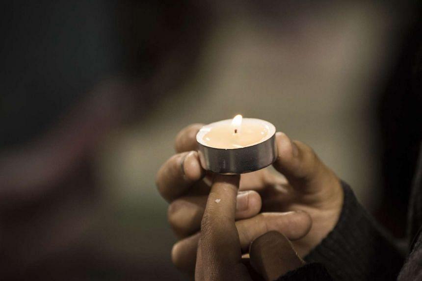 People attend a candlelight vigil at the San Manuel Stadium in San Bernardino, California.
