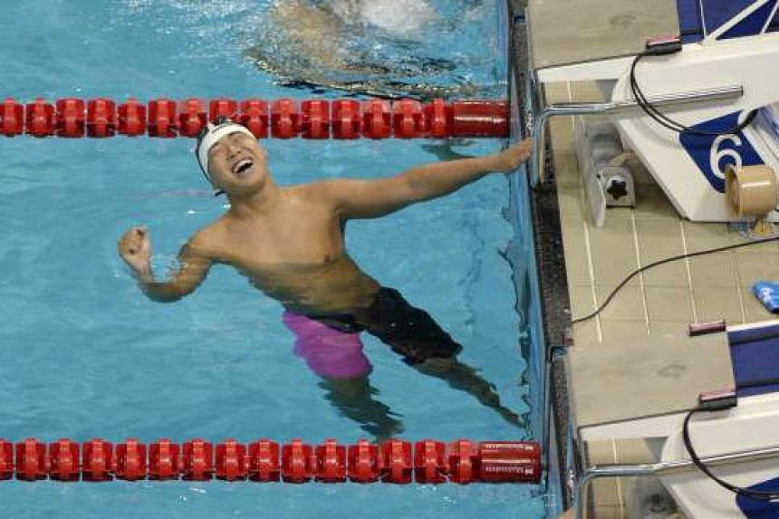 Han Liang Chou of Singapore (lane 6) raises his fist after winning the Men's 100m Breaststrokeat the 8th Asean Para Games.