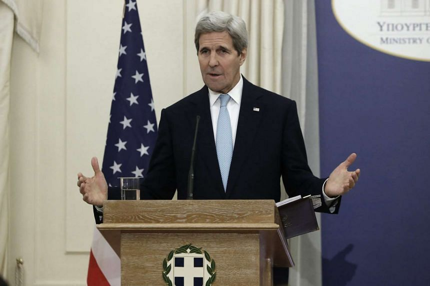 US Secretary of State John Kerry addresses reporters during a press conference.
