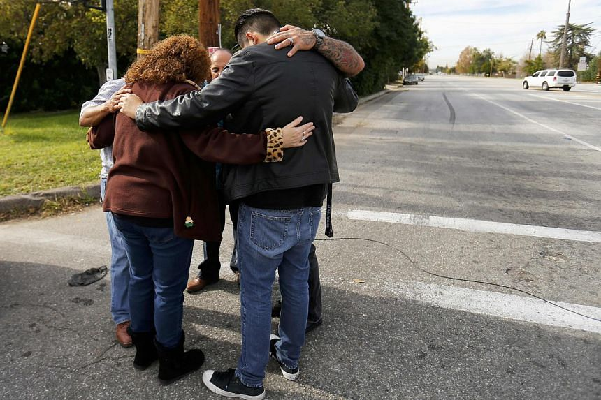 Local residents as they wait to return to their homes near the scene of a mass shooting in San Bernardino on Dec 3.