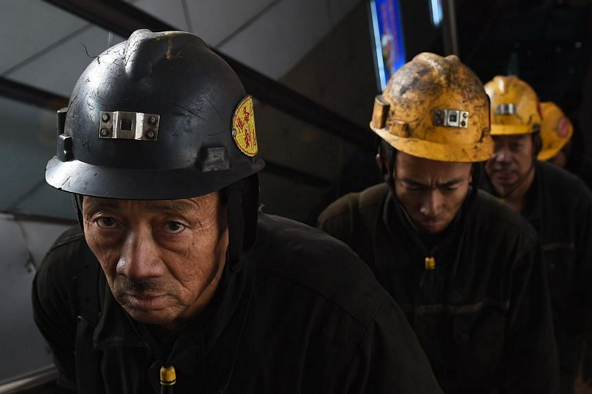 In this photo taken on Nov 20, coal miners exit a mine after their shift underground at Datong, China.