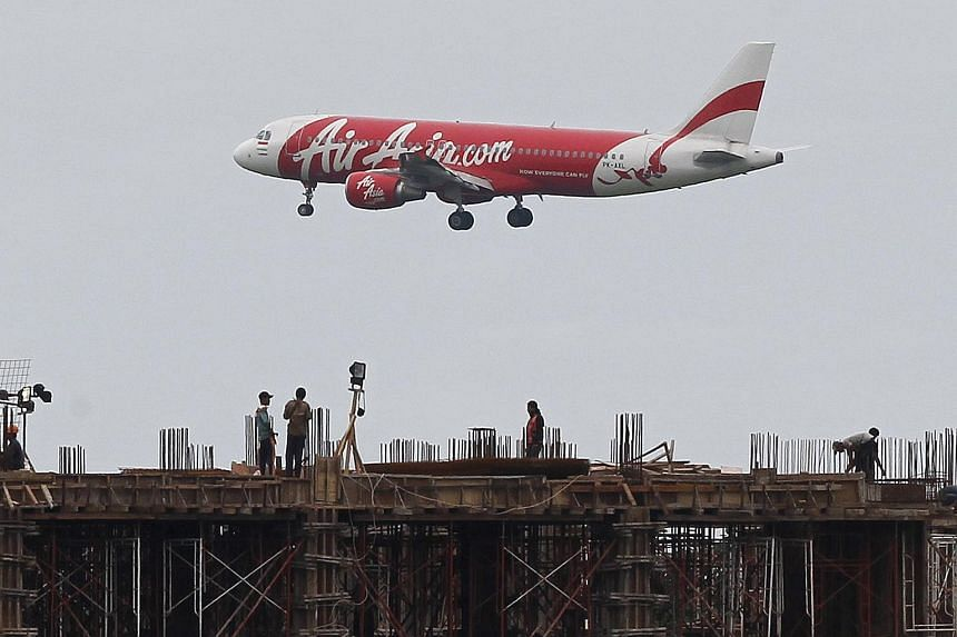 File photo of an Indonesia AirAsia Airbus A320-200 passenger preparing to land at Sukarno-Hatta airport in Tangerang, Indonesia.