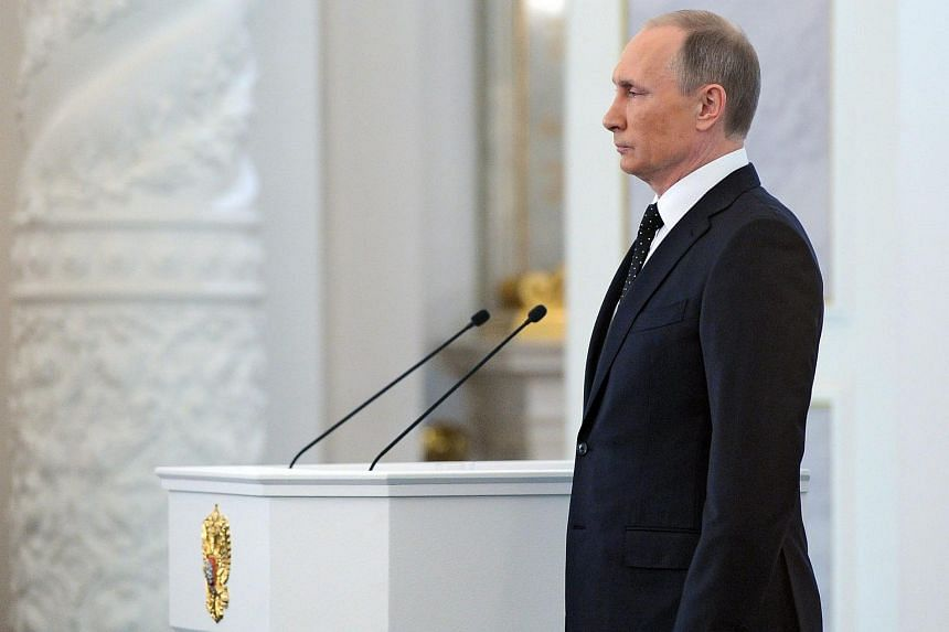 Russian President Vladimir Putin during his annual address to the Federal Assembly in St. George's Hall of the Grand Kremlin Palace in Moscow on Dec 3.