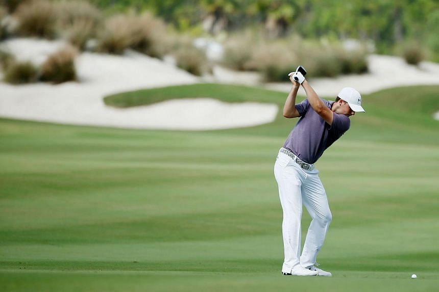 Jordan Spieth of the US hits his second shot on the third hole during the first round of the Hero World Challenge in the Bahamas on Dec 3.