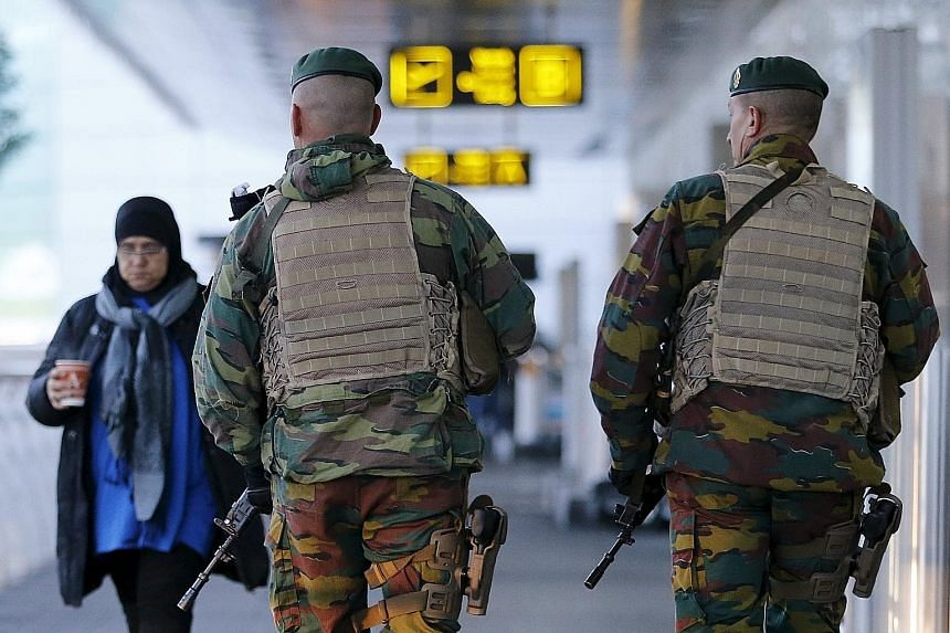 Belgian soldiers on patrol at Zaventem international airport near Brussels last month, as security was tightened after the Nov 13 Paris attacks. One of the two new suspects who were arrested on Sunday was a 20-year-old Frenchman who was caught at the