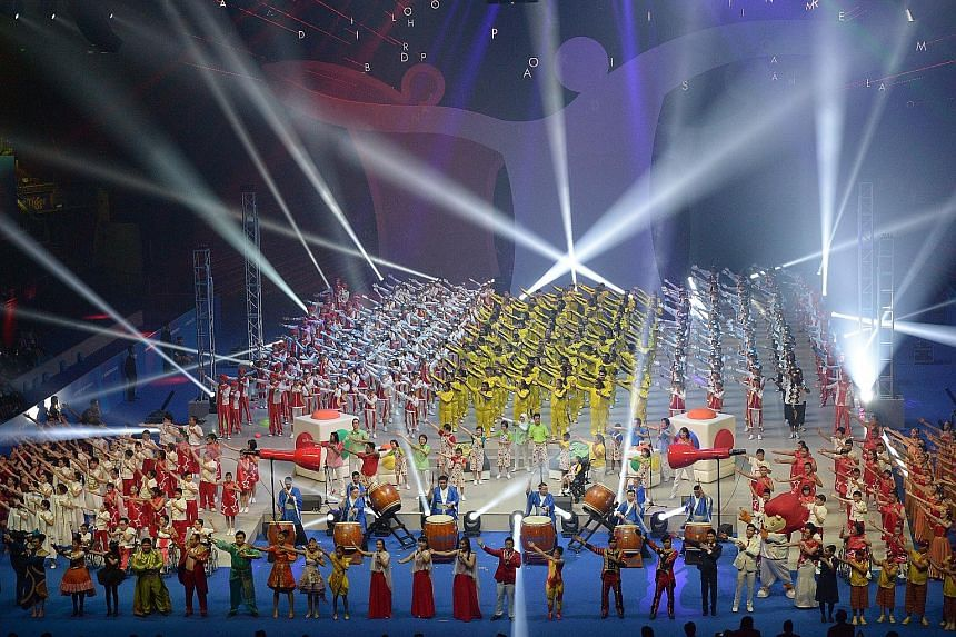 Performers at the finale of yesterday's opening ceremony of the 8th Asean Para Games at the Singapore Indoor Stadium. The week-long Games, which Singapore is hosting for the first time, will see about 1,200 para athletes compete in more than 300 even