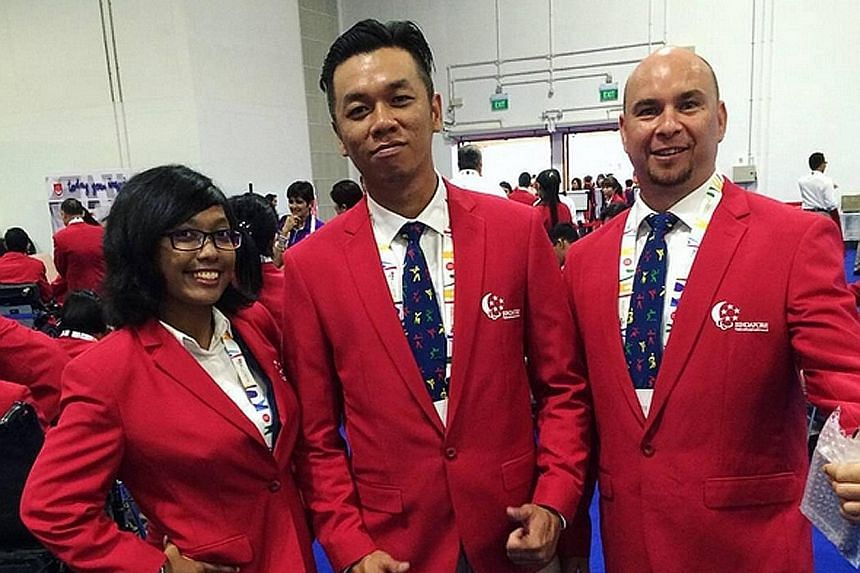 "Nur Syahidah Alim with archery team-mates Kevin Wong and Robert Fuchs before the Opening Ceremony: ""We are all (red)y to go for the opening ceremony!"""