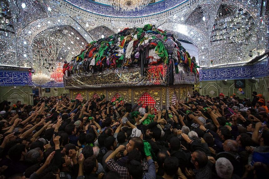 Shi'ite pilgrims gathering at the Imam Hussein shrine during a ceremony marking Arbain in the holy city of Karbala in southern Iraq this week. Iraqi Shi'ites visit Karbala to perform the ceremony of Arbain on the 40th day after the Shi'ite holy day o