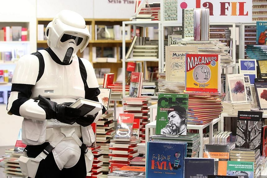 People dressed up as Star Wars characters attending the Guadalajara International Book Fair in Guadalajara, Mexico, on Wednesday. They were given free entry into the Expo Guadalajara convention centre, where the most famous literary fair for Hispanic